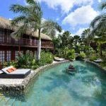 Met kokosnoten onder de Caribische zon genieten vanuit geweldig resort